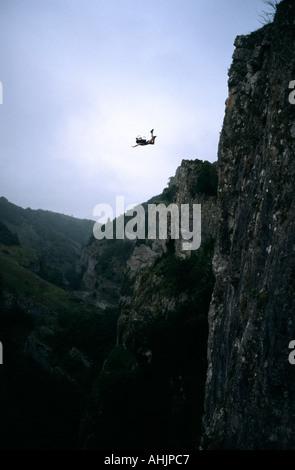 UK Naked BASE 1 BASE Jumping off Cheddar Gorge Avon England Great Britain - Stock Image