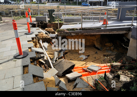 Footpath and walkway washed away in flash flood. - Stock Image