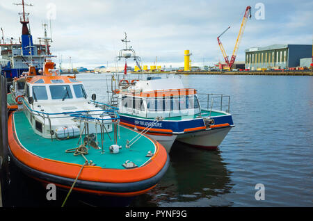 Pilot boat Coatham, and Harbour Master's boat High Tide Adventure moored on the River Tees in central Middlesbrough - Stock Image