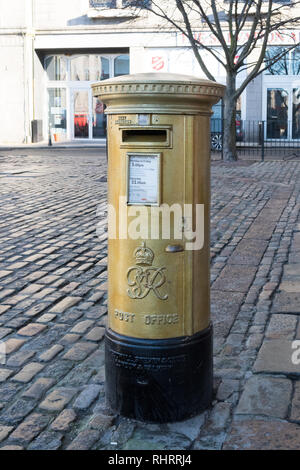 Gold post box celebrating the 2012 summer olympics gold medal winner Katherine Grainger who won gold in Rowing - Women's Double Sculls - Aberdeen - Stock Image