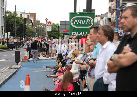 London, UK. 07th July, 2014. Londoners lined up the street despite the rain to cheer the peloton in Newham. Credit: - Stock Image