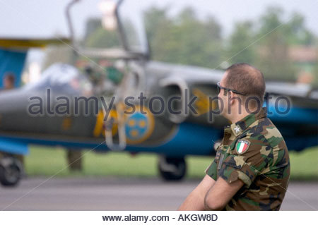 Sk60A Saab 105 on Rivolto Italia Air show 2005 protected by Italian security guard soldier - Stock Image
