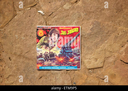 Indian firework wrapper with military graphics. India - Stock Image
