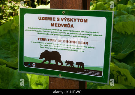 Poloniny National Park sign informing about Brown Bear territory, Slovakia - Stock Image