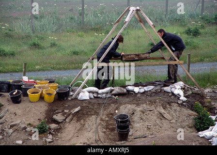 Archaeologists working on active dig Scatness Iron Age Village Shetland Islands Scotland United Kingdom Great Britain Europe - Stock Image