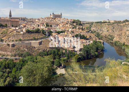 Toledo, Toledo Province, Castilla-La Mancha Spain.  Overall view of the historic centre showing the Tagus River (Rio Tajo) with the Alcazar centre and - Stock Image