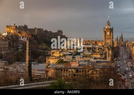 A view of Edinburgh City Centre from Carlton Hill with the Balmoral Hotel, Princes Street and the castle in the foreground - Stock Image