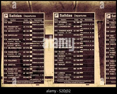 Departures Boards at a major international airport in Europe. Keep your eyes open - you need to know which departure gate your aircraft leaves from! Photo Credit - © COLIN HOSKINS. - Stock Image