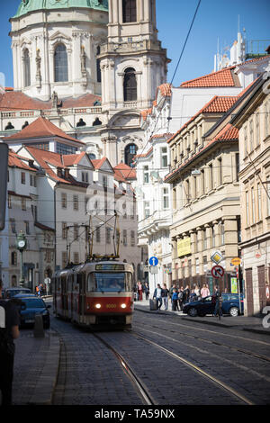 Czech Republic, Prague 16-04-2019: people walking on the streets. a local tram riding on the rails. Mid shot - Stock Image