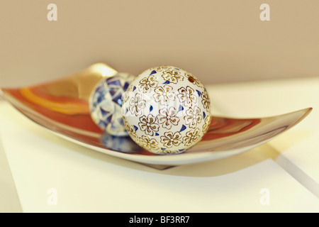 Decorative balls on a tray - Stock Image