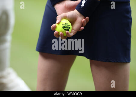 Wimbledon, UK. 11th July 2019, The All England Lawn Tennis and Croquet Club, Wimbledon, England, Wimbledon Tennis Tournament, Day 10; Ball girl holding a game ball during the ladies semi final singles match between Serena Williams (usa) and Barbora Strýcová (cze) Credit: Action Plus Sports Images/Alamy Live News - Stock Image