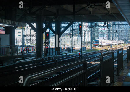 A train departs form  a railway station in Seoul, South Korea. - Stock Image