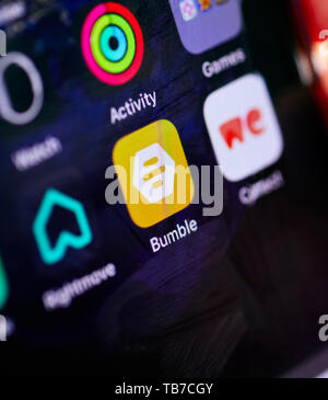 Bumble dating app on iPhone - Stock Image
