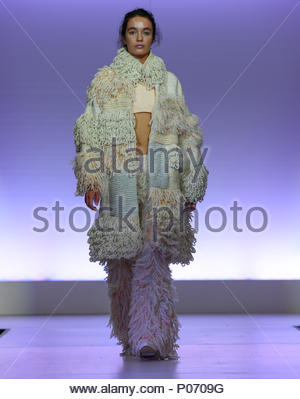 Southampton, England, UK,  8th June 2018. Solent university tonight held its BA (HONS) Fashion graduate show in Southampton to showcase the skills and imagination of the final year students. This collection is from student Sofia Elisa Ferrara the inspiration is taken from the deteriorating buildings of Morocco. Paul Watts/Alamy live news Credit: PBWPIX/Alamy Live News - Stock Image