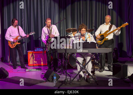 Walsall, West Midlands, UK. 22 March 2015. English singer songwriter Jona Lewie (at Yamaha) with the band The Parnells - Stock Image
