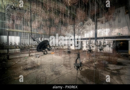 Interior view with baskets, used as lockers for the miners, in an abandoned mine in Germany. - Stock Image