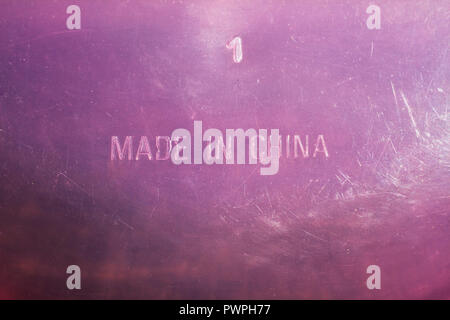 Close-up of the bottom of a plastic container inlaid with 'Made in China' - Stock Image