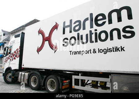 Floro, Norway, July 24, 2018: Harlem Solutions large truck is making a tight left turn in the streets of Floro. - Stock Image