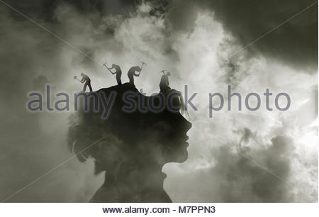 Workmen with sledgehammer and pick axes pounding inside of woman's head - Stock Image