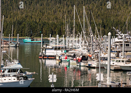Public marina and port in the tiny village of Petersburg on Mitkof Island along the Wrangell Narrows in Frederick Sound with the Alaska Coast Range of mountains behind on Mitkof Island, Alaska. Petersburg settled by Norwegian immigrant Peter Buschmann is known as Little Norway due to the high percentage of people of Scandinavian origin. - Stock Image