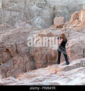 Lady taking pictures in White Canyon. South Sinai. Egypt - Stock Image