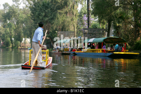 Man Selling Toffee Apples and Sweetmeats on a Boat on the Canals of the Floating Gardens of Xochimilco Mexico City - Stock Image