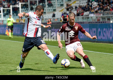 Turin, Italy. 14th Apr, 2019.  Serie A football, Torino versus Cagliari; Cristian Ansaldi of Torino FC looks to get past Simone Padoin of Cagliari Credit: Action Plus Sports Images/Alamy Live News - Stock Image