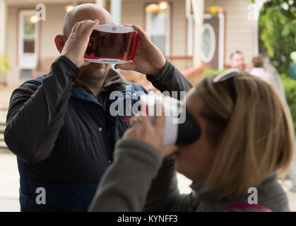 Brian and Kristen Gratton of Mars, Pennsylvania view the terrain of Mars through virtual reality headsets during - Stock Image