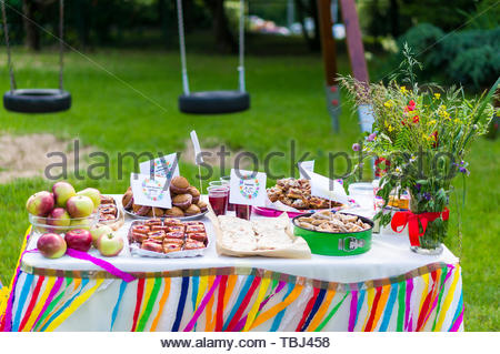 Table with variation of baked food and fresh - Stock Image