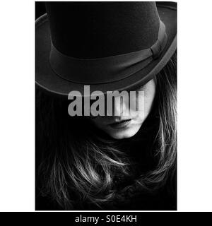 Girl with hat in black and white - Stock Image
