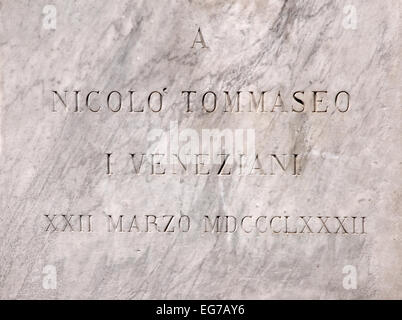 Plaque on statue of author and linguist Niccolo Tommaseo in Campo San Stefano Venice Italy - Stock Image