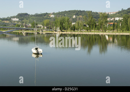A little boat in the Mondego river. - Stock Image