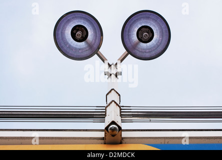 overhead lights in shopping area - Stock Image
