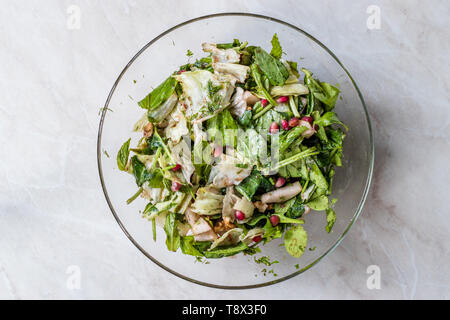 Pomegranate Salad with Mint Fresh Leaves in Glass Bowl. Fresh Organic Food. - Stock Image