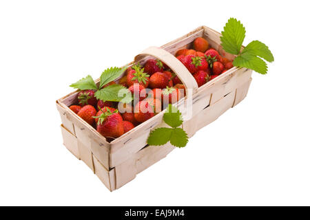 Fresh juicy strawberries in wooden basket isolated on white - Stock Image