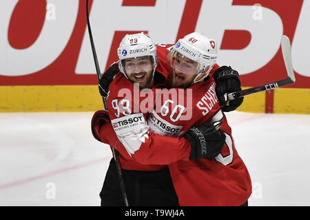 Bratislava, Czech Republic. 21st May, 2019. L-R Lino Martschini and Tristan Scherwey (both SUI) celebrate first goal during the match between Czech Republic and Switzerland within the 2019 IIHF World Championship in Bratislava, Slovakia, on May 21, 2019. Credit: Vit Simanek/CTK Photo/Alamy Live News - Stock Image