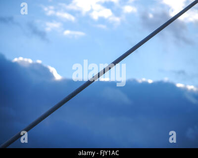 Close-Up Of Rope Against Cloudy Sky - Stock Image