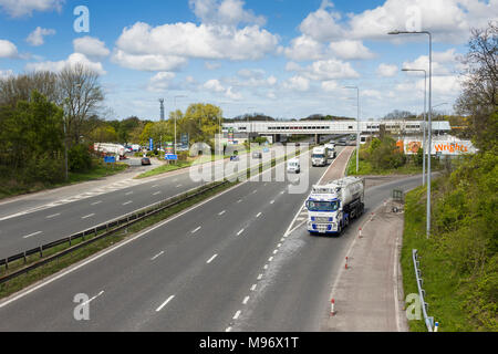 M6 motorway in Lancashire at Charnock Richard services, looking north with Simon Gibson tanker joining the southbound carriageway. - Stock Image
