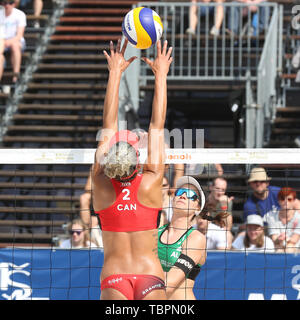 Ostrava, Czech Republic. 01st June, 2019. L-R Brandie Wilkerson (Canada) and Lena Plesiutschnig (Austria) in action during the four-star J&T Banka Ostrava Beach Open 2019, part of the FIVB Beach Volleyball World Tour, in Ostrava, Czech Republic, on July 1, 2019. Credit: Petr Sznapka/CTK Photo/Alamy Live News - Stock Image