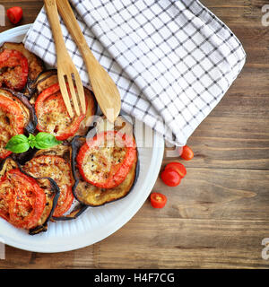 Tasty vegetarian pizza topping, delicious baked eggplant with tomato and cheese, traditional italian food, healthy - Stock Image