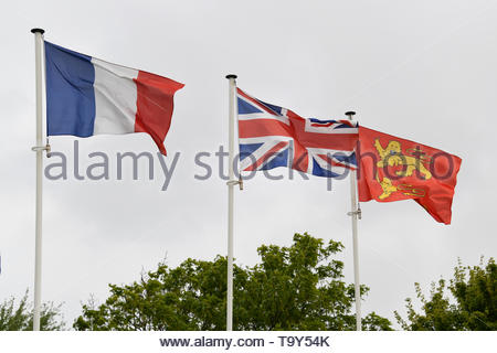 Statue of Monty - General Montgomery in Colleville-Montgomery, Normandy in France with flags flying. Flag of Normandy, French and Union Jack - Stock Image