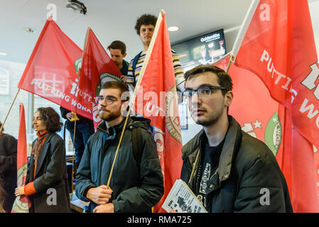 London, UK. 14th February 2019. Students  to speeches in the foyer of the Ben Pimlott Building, briefly occupied as the IWGB union and students launch their campaign for Goldmsiths, University of London, to directly employ its security officers. Currently they are employed by CIS Security Ltd on low pay and minimal conditions of service, and CIS routinely flouts its legal responsibilities on statutory sick pay and holidays. Credit: Peter Marshall/Alamy Live News - Stock Image