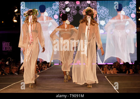 Montreal,Canada. Models walk on the runway at the La Vie en Rose fashion show held during the Fashion and Design Festival. - Stock Image