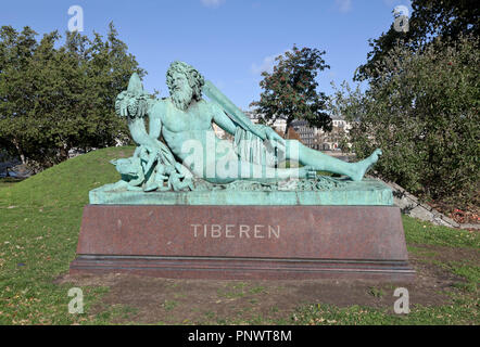 The Tiberen, the Tiber, bronze sculpture on granite named after the river Tiber in Italy at Sortedam Lake at Søtorvet in Copenhagen. See description. - Stock Image