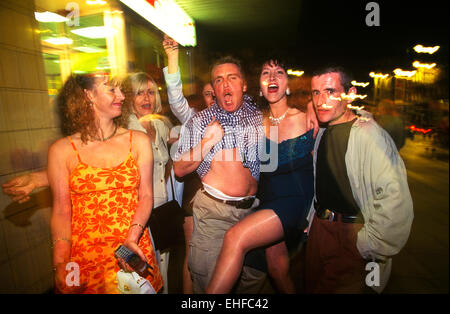 Group of friends on a night out on The Big Market in Newcastle. - Stock Image