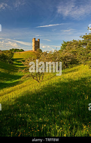 Broadway Tower stands on top of Fish Hill in the northern Cotswolds, and is a local viewing point as well as a medieval folly castle. - Stock Image
