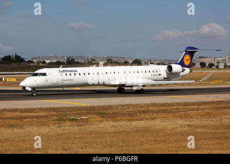 Bombardier CRJ900 small jet airliner operated by Lufthansa CityLine taxiing for departure from Malta. Air travel in Europe. - Stock Image