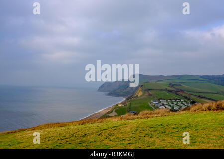 Walkers on the coastal path at West Bay overlooking coastline in West Dorset UK - Stock Image