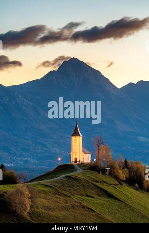 St. Primus and Felician church at dusk. Jamnik, Kranj, Upper Carniola, Slovenia - Stock Image