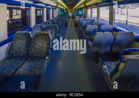 Cascais, Portugal - January 13th, 2018: Seats inside an empty Portuguese train at Cascais Station - Stock Image